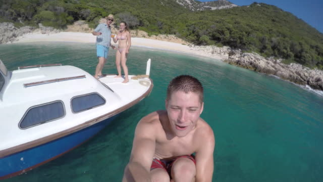 POV Young man jumping off the boat