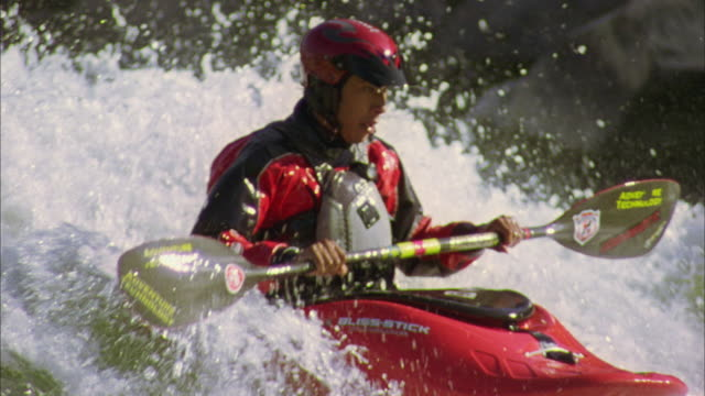 MS TS SLO MO Young man kayaking in rapid waters / Glenwood Springs, Colorado, USA