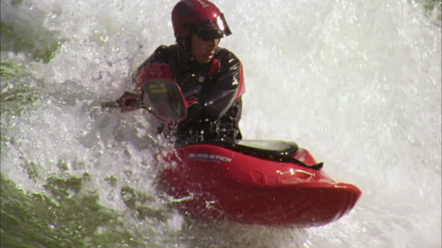 ms ts slo mo young man kayaking in rapid waters / glenwood springs, colorado, usa - rapid stock videos & royalty-free footage