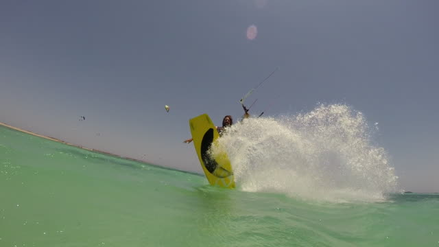A young man kite boarding.  - Slow Motion - filmed in Soma Bay, Egypt, Africa
