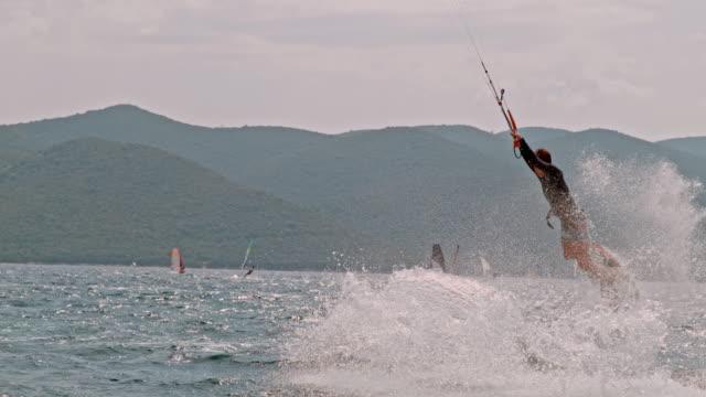 ms young man kiteboarding on sunny ocean,peljesac,croatia - croatia stock videos & royalty-free footage