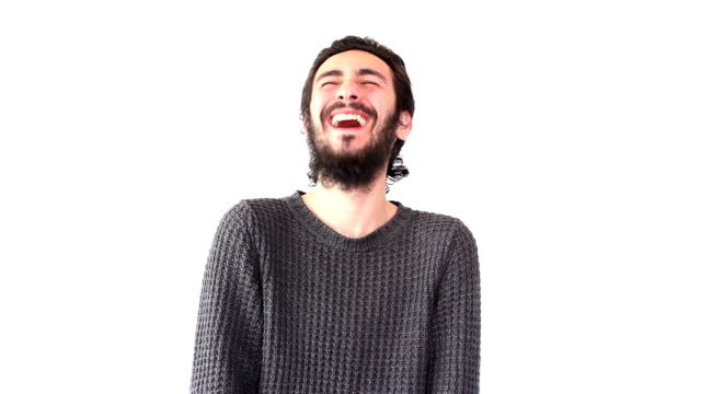 Young man laughing in happiness over white background