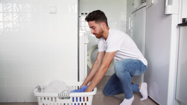 Young man laundry chores