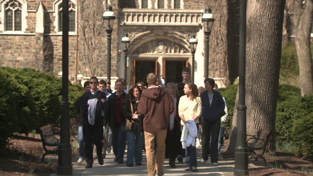 MS Young man leading group of people on tour through university campus, Bethlehem, Pennsylvania, USA