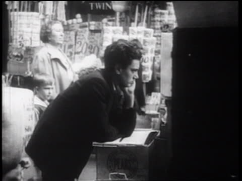 b/w 1939 young man leaning on box outdoors / nyc / documentary - one teenage boy only stock videos and b-roll footage