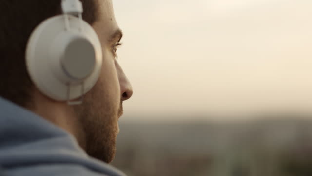 young man listening music - headphones stock videos & royalty-free footage