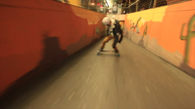a young man longboard skateboarding downhill in a city at night. - verboten stock-videos und b-roll-filmmaterial