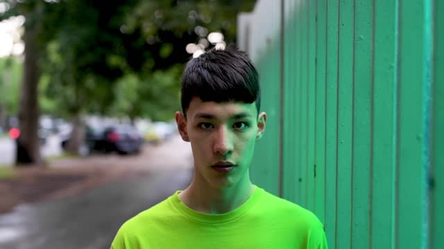 young man looking at camera in the city - t shirt stock videos & royalty-free footage