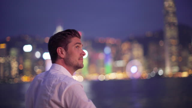 RV young man looking at Hong Kong skyline
