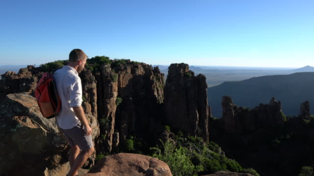 young man looking at view from mountain top - south africa stock videos & royalty-free footage