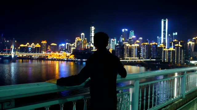young man looking city skyline in chongqing - one man only stock videos & royalty-free footage