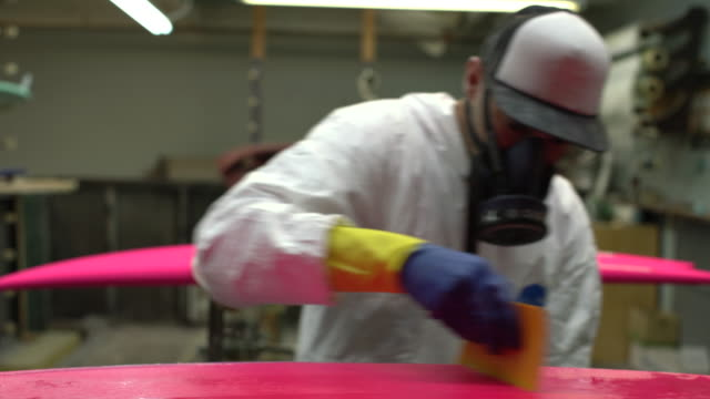 ms young man making a surfboard in his workshop - fibreglass stock videos and b-roll footage