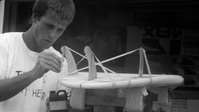 young man making surfboard - glue stock videos and b-roll footage