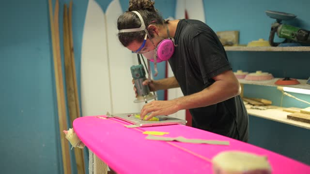 young man making surfboard - surfboard stock videos & royalty-free footage
