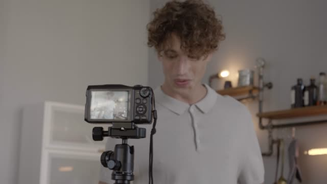 young man making video blog for preparing dessert with milk - milchprodukte stock-videos und b-roll-filmmaterial