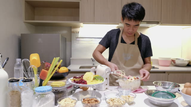 Young man mixing ingredient to make a sweet food