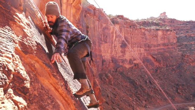 young man mountain climber in moab - moab utah stock videos & royalty-free footage