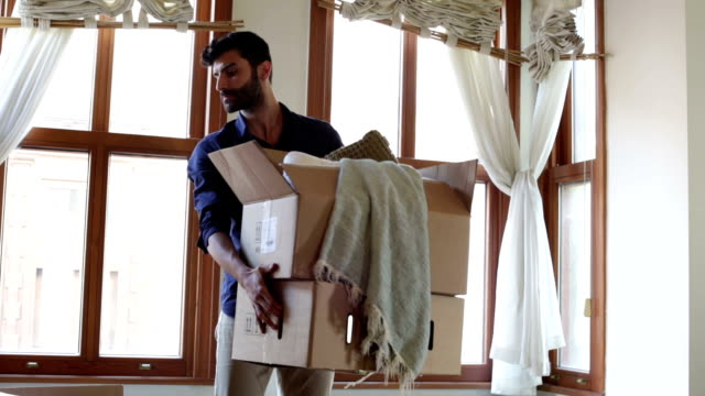 young man moving house - housework stock videos and b-roll footage