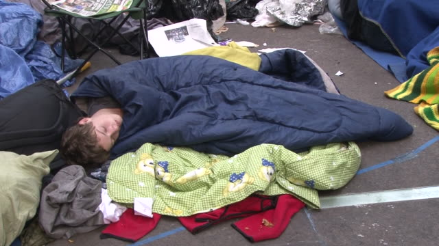A young man naps in a sleeping bag on the ground in Zuccotti Park during the Occupy Wall Street protests in Lower Manhattan