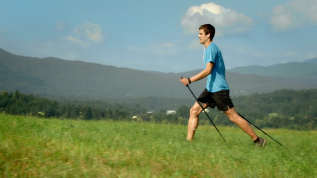 hd dolly: young man nordic walking - pole stock videos & royalty-free footage