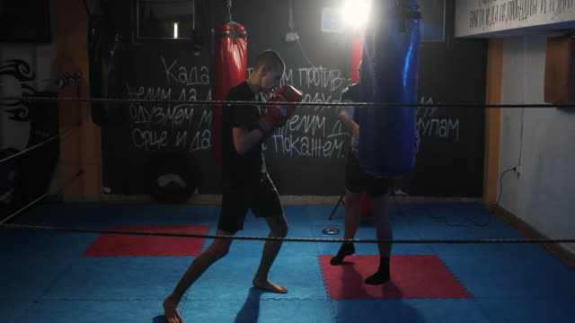 young man on kick box training with his coach - martial arts stock videos & royalty-free footage