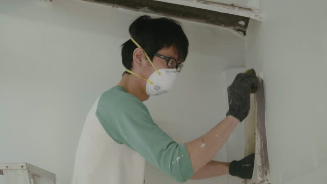 diy young man on ladder cleaning and repairs in kitchen. - air duct stock videos & royalty-free footage