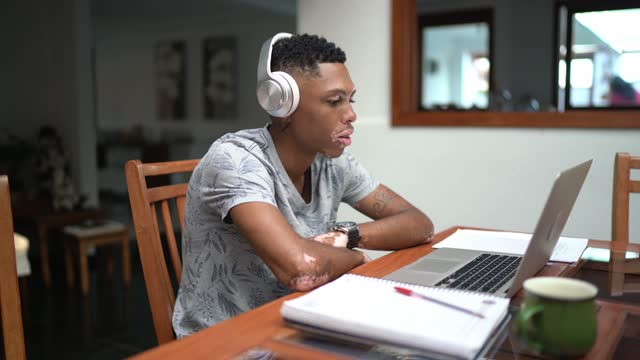 young man on video class studying at home - university student stock videos & royalty-free footage