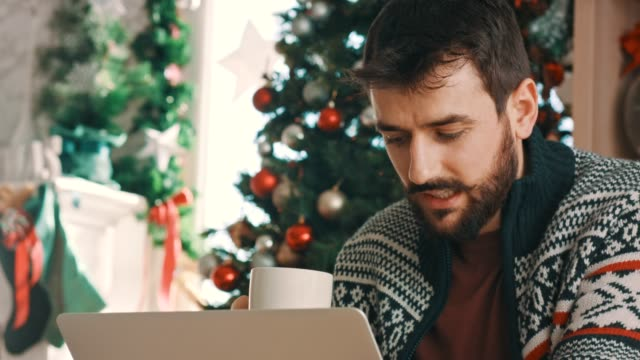 young man online shopping for christmas presents - sitting stock videos & royalty-free footage