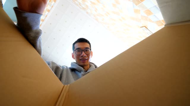 young man opening a parcel - cardboard box stock videos & royalty-free footage