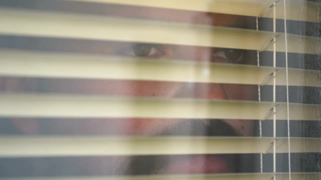 young man opening blinds in home - curtain stock videos & royalty-free footage