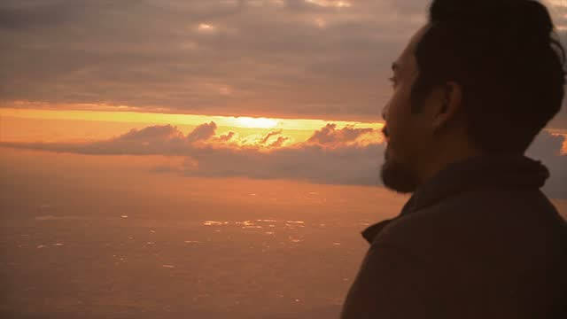 young man overlooking the view of the nature at sunrise - standing stock videos & royalty-free footage