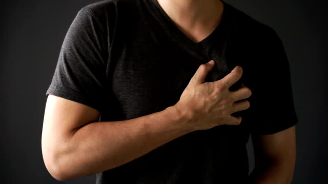 young man painful on his heart - chest torso stock videos & royalty-free footage