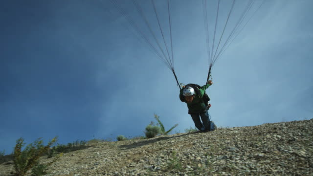 ws pan pov young man paragliding mid-air / lehi, utah, usa. - lehi stock videos & royalty-free footage