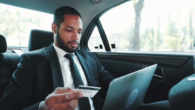 young man paying on the move. - business travel stock videos & royalty-free footage