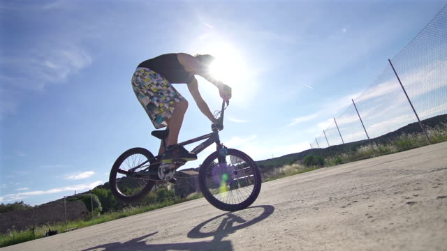 Young man performing a trick on a BMX bike