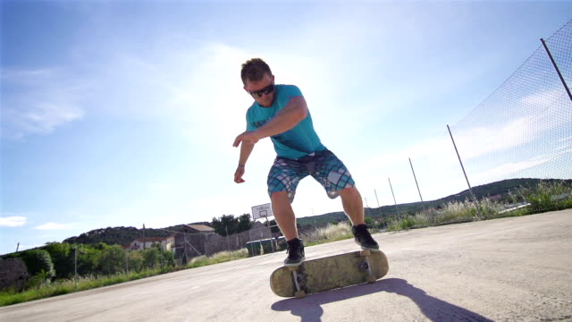 Young man performing a trick on a skateboard