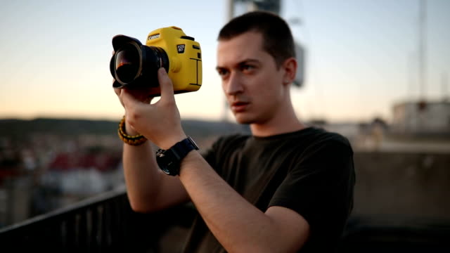 young man photographing - freelance work stock videos & royalty-free footage