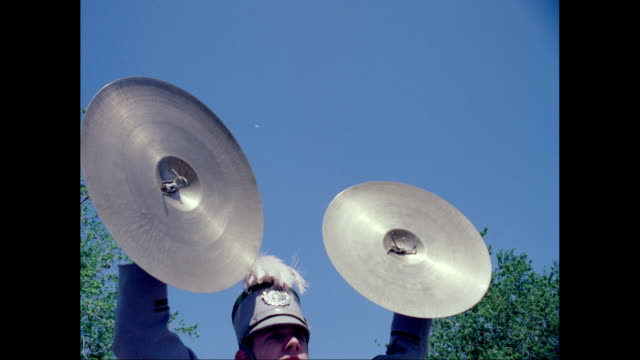 MS Young man playing cymbal during carnival / United States