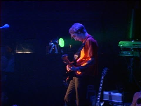 vídeos y material grabado en eventos de stock de profile young man playing guitar on stage - rock moderno