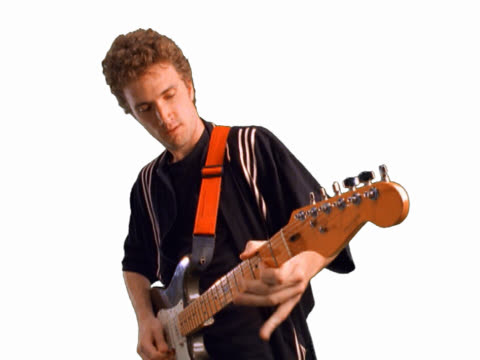 Young man playing guitar riff and singing