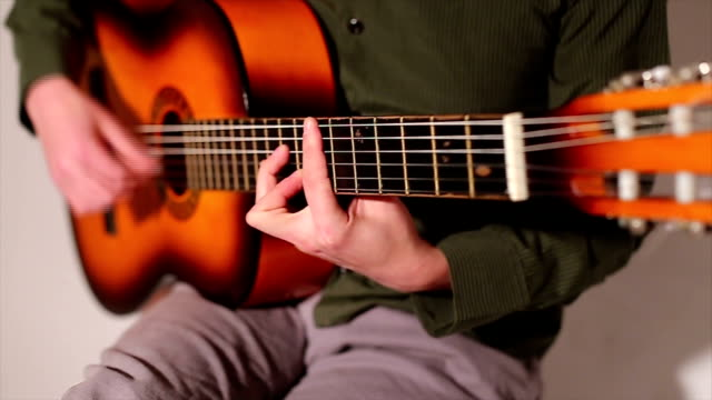 young man playing guitar - classical style stock videos & royalty-free footage