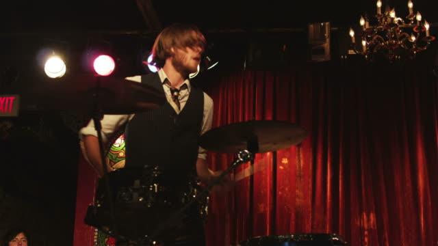 ms pan young man playing percussion in nightclub, provo, utah, usa - hemd und krawatte stock-videos und b-roll-filmmaterial