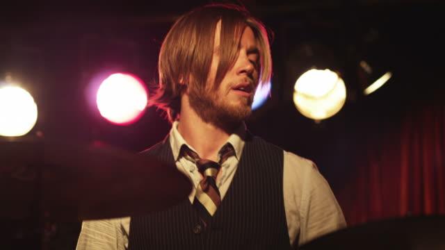 cu td young man playing percussion in nightclub, provo, utah, usa - hemd und krawatte stock-videos und b-roll-filmmaterial