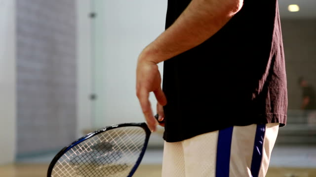MS TU Young man playing racquetball in court / Lamy, New Mexico, USA