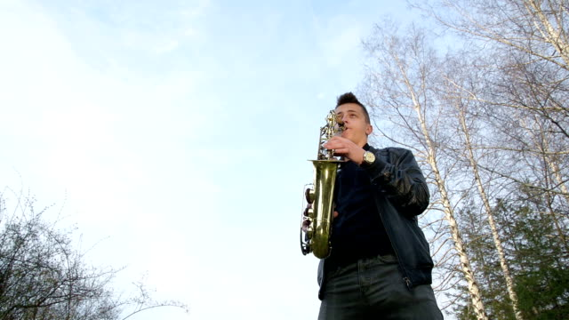 young man playing sax. - saxophone stock videos and b-roll footage