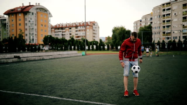 young man playing with soccer ball - international soccer event stock videos & royalty-free footage