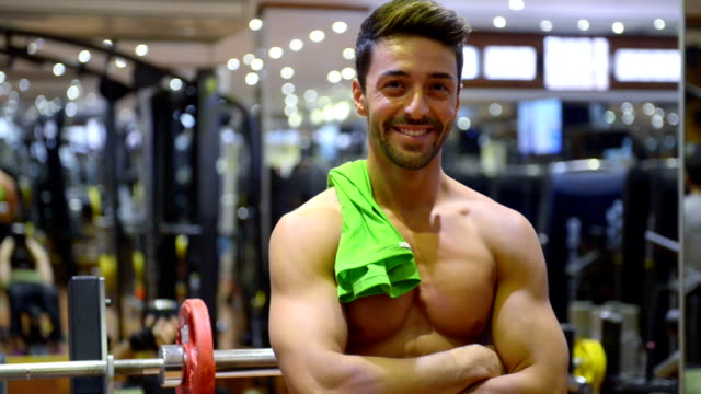 Young man posing in the gym