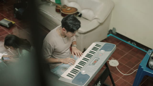 young man practicing piano at home stock video - piano stock videos & royalty-free footage