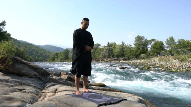 young man praying  outdoors in nature - mature adult stock videos & royalty-free footage