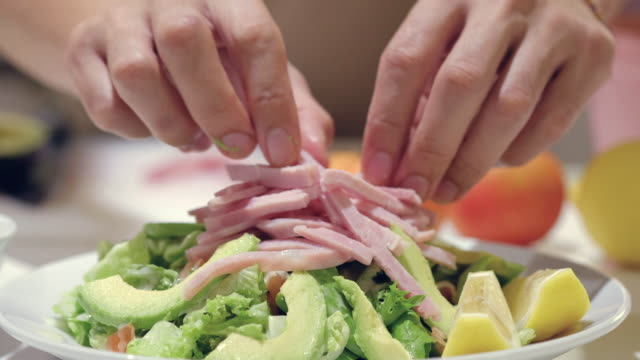 young man preparing salad - avocado salad stock videos & royalty-free footage